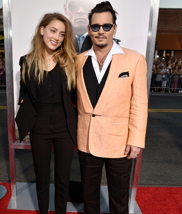 "BOSTON, MA - SEPTEMBER 15:  Actors Amber Heard (L) and Johnny Depp attend the ""Black Mass"" Boston special screening at the Coolidge Corner Theatre on September 15, 2015 in Boston, Massachusetts.  (Photo by Paul Marotta/Getty Images for Warner Brothers)"