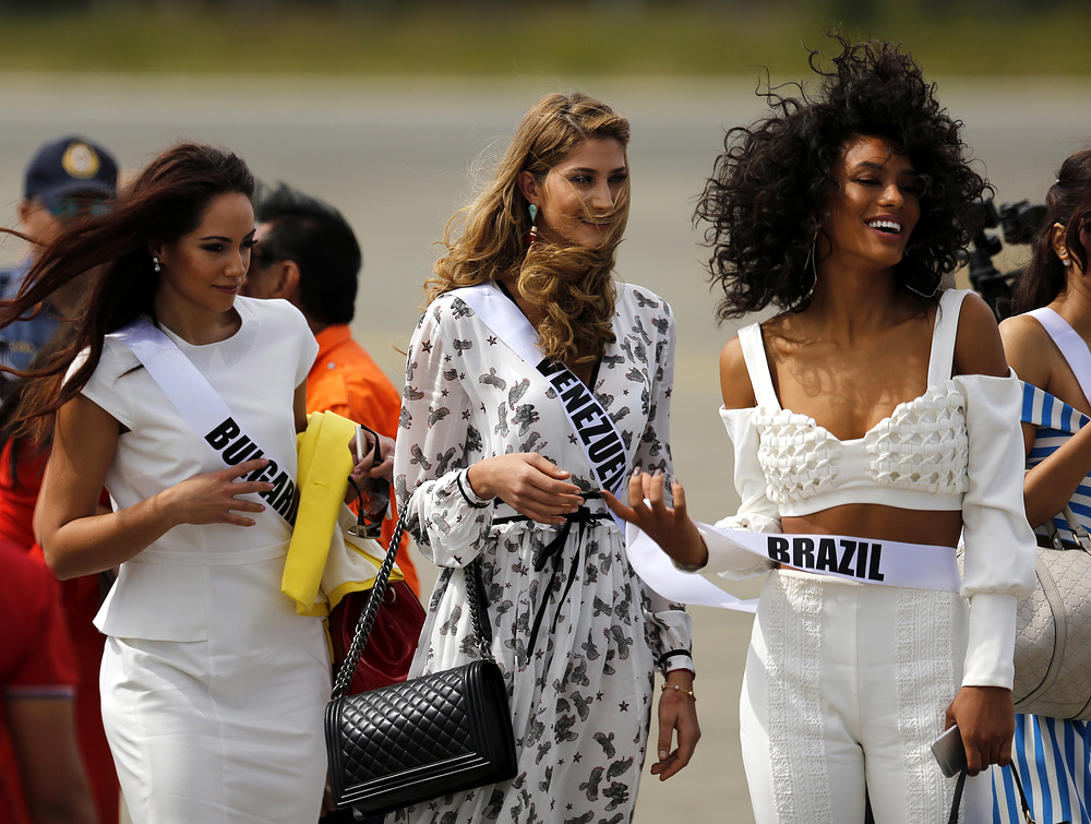 epa05718230 Miss Universe candidates Violina Ancheva (L) from Bulgaria, Mariam Habach (C) from Venezuela, and Raissa Santana (R) from Brazil disembark from an airplane during a visit to the Hispanic colonial city of Vigan, Philippines, 15 January 2017. Contestants participate in several events prior to their competition for the Miss Universe title, which will take place on 30 January. More than 80 candidates will compete in the grand coronation of the 65th Miss Universe beauty pageant at the SM Mall of Asia Arena in Pasay City.  EPA/FRANCIS R. MALASIG