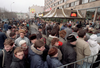 FILE-- In this Wednesday, Jan. 31, 1990, file photo, hundreds of people line up around the first McDonald's restaurant in the Soviet Union at Moscow's Pushkin Square, on its opening day. McDonald's will expand by 45 outlets in Russia by the end of this year, CEO James Skinner said Monday as the company marked the 20th anniversary of the opening of the first landmark restaurant under Soviet rule in 1990. The expansion will bring the number of McDonald's in Russia to 290.(AP Photo/Alexander Zemlianichenko, File)